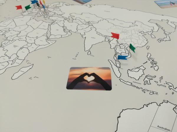 Weltkarte mit Fotos deiner Reisen